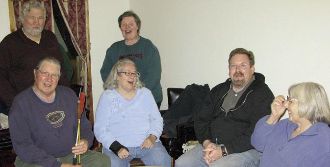 Phil White Hawk, Cindy Keller, Tom Thornton III, and Laura Sullivan. Standing, Mike Dunn and Judy Thornton