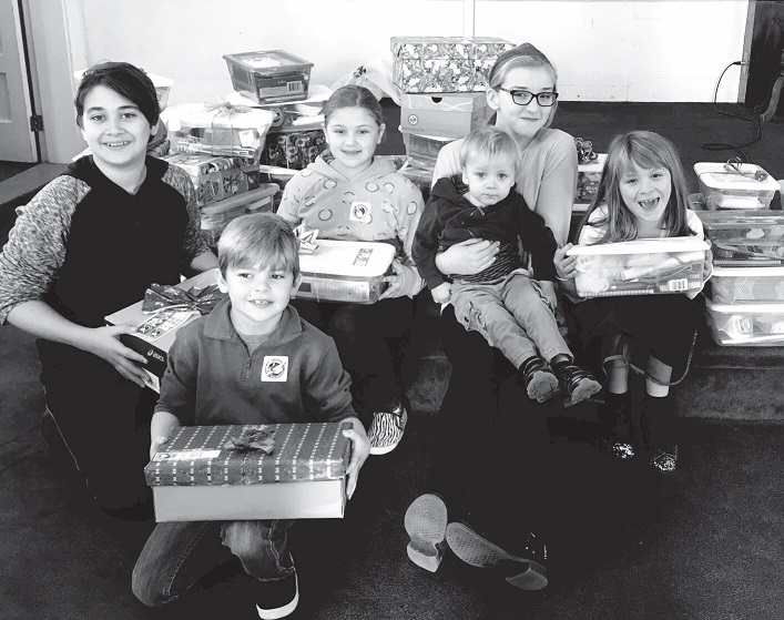 Some of the children from families who have contributed shoeboxes when the boxes were collected on November 13, in the morning worship service.                                                                Contributed photo